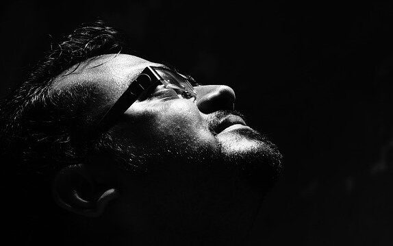 Man looking up with eyes closed